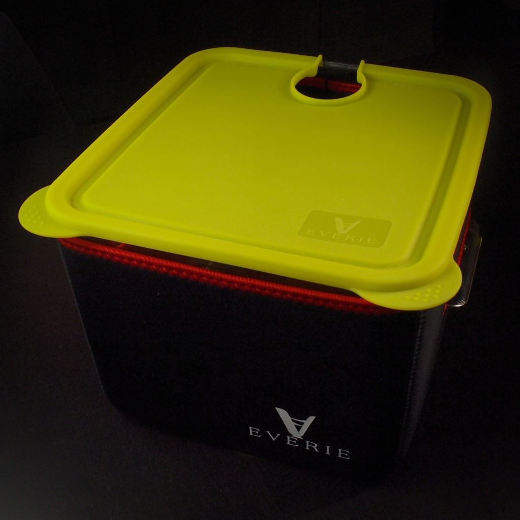 A 12 quart clear Rubbermaid commercial-grade food container with a black insulating jacket and yellow silicone lid to allow use as a Sous Vide container.
